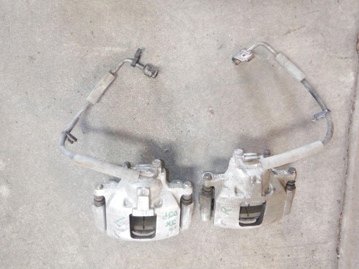 Pair JK New OEM Take Off Front Calipers, Pads, Hoses Image