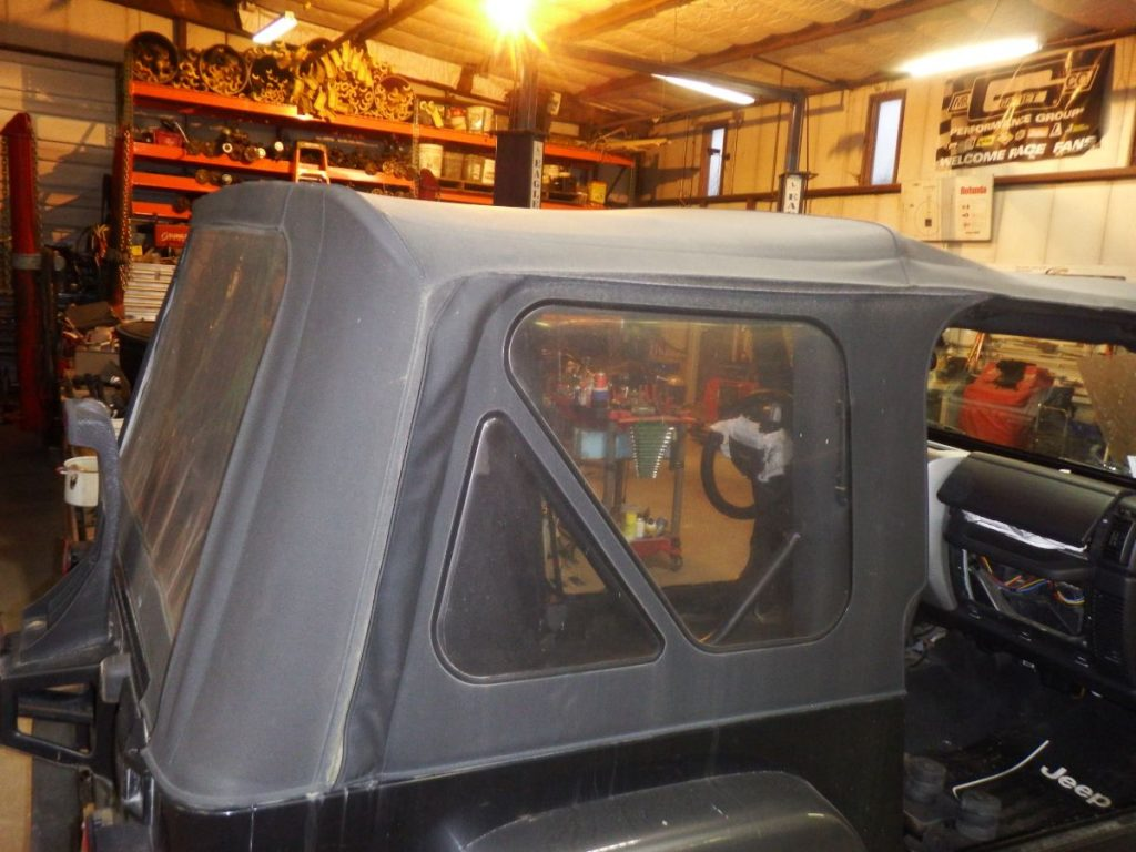 04 TJ OEM Soft Top w/ Door Surrounds & Bow Assembly 300 Image