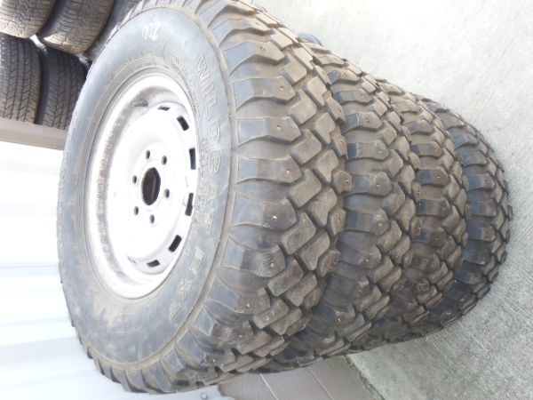 Chevy 6 Bolt Rims with Studded Tires Image